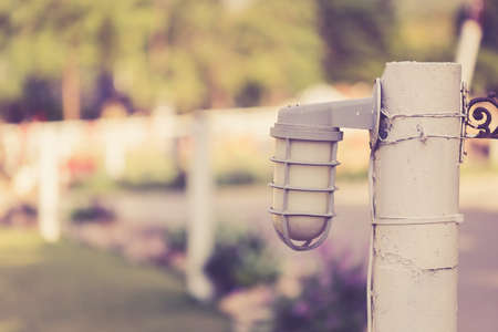 garden lamp: Garden lamp on wooden pole, vintage color