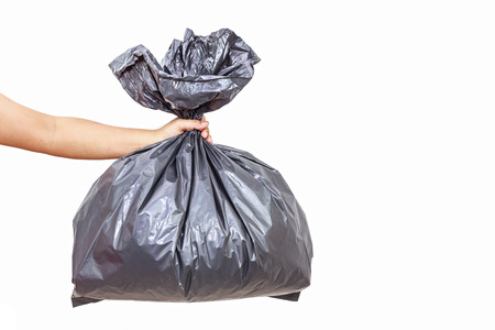 Close up Hand holding a garbage bag on white background