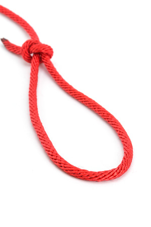 Red rope with knotted isolated on white background