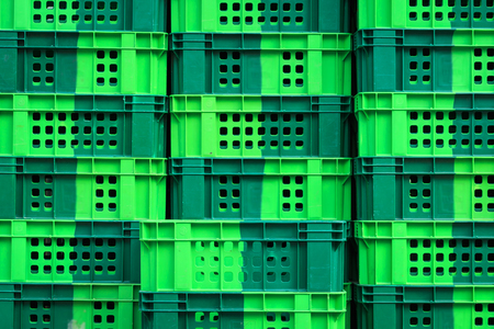 Stack of empty green crate photo