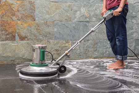 Thai people cleaning black granite floor with machine and chemical Stok Fotoğraf
