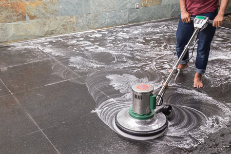 granite floor: Thai people cleaning black granite floor with machine and chemical Stock Photo