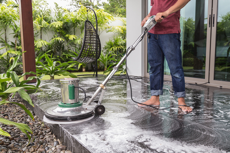 buffing: Thai people cleaning black granite floor with machine and chemical Stock Photo
