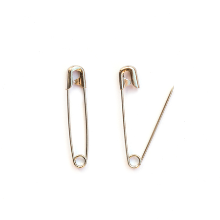 safety pin: Close up Safety pin isolated on white background