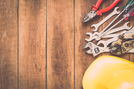 Close up of assorted work tools on wooden background photo