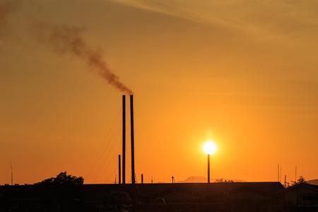 smokestacks: Silhouette of Smokestacks at sunset time Stock Photo