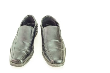 mans: Old black mans shoes isolated on white background Stock Photo