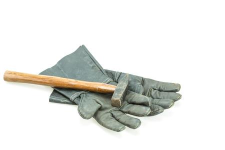 work glove: Black safety work glove and hammer isolated on white background