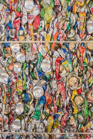 crushed aluminum cans: PHUKET, THAILAND - MARCH 3 : Crushed soda and beer cans at a recycling facility in Phuket on March 3, 2015. The cans will be shipped to an aluminum foundry. Editorial