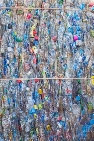 shipped: PHUKET, THAILAND - MARCH 3 : Crushed plastic bottles at a recycling facility in Phuket on March 3, 2015. The bottles will be shipped to a plastic foundry.