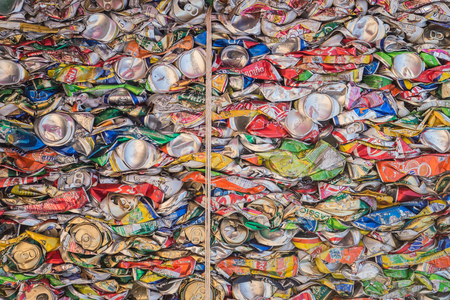 PHUKET, THAILAND - MARCH 3 : Crushed soda and beer cans at a recycling facility in Phuket on March 3, 2015. The cans will be shipped to an aluminum foundry. Editorial