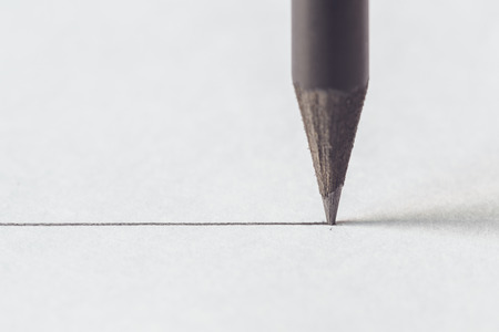 Close up Black pencil with stroke on white paper Foto de archivo