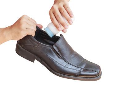 odor: Close up Hand put powder to a shoe, odor stop