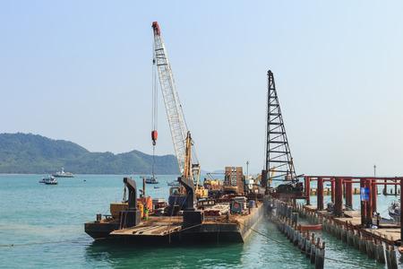 orenge: crane on construction site at the pier Stock Photo