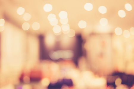 busy restaurant: blurred image of shopping mall with bokeh, vintage color