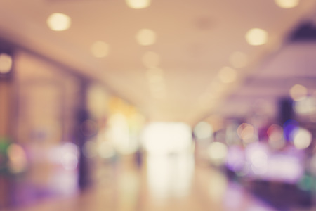 shop window display: blurred image of shopping mall with bokeh, vintage color