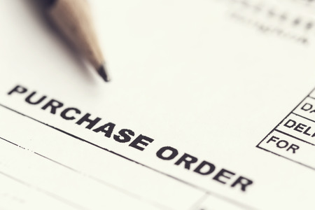 Macro Purchase order with pencil 스톡 콘텐츠