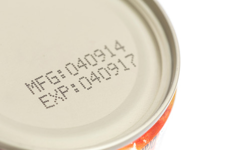 date: Macro expiration date on canned food isolated on white background