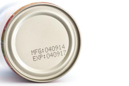 expire: Macro expiration date on canned food isolated on white background