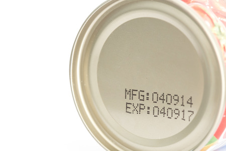 expiration date: Macro expiration date on canned food isolated on white background