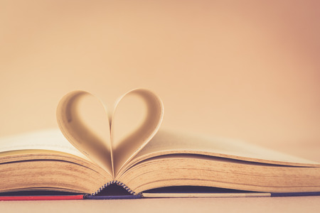 open concept: Close up Book with heart sign, vintage color Stock Photo
