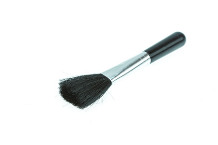 Brush for cleaning camera isolated on white background photo