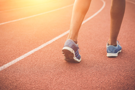 Close up runner feet on running stadium