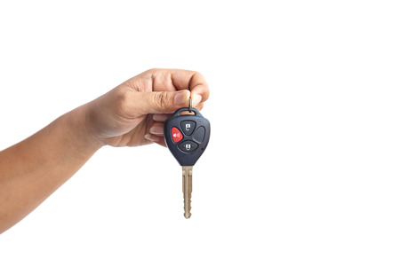 Hand holding car key isolated on white background Archivio Fotografico
