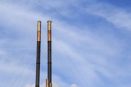 smokestacks: Smokestacks on blue sky background