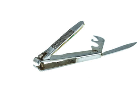 Old nail clipper isolated on white background photo