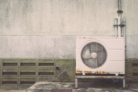 compressor: Air conditioning compressor near the wall