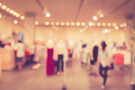 retail scene: Blurred image of people in shopping mall with bokeh, vintage color Stock Photo