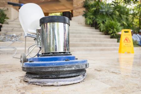 Close up blue polishing machine on the stone floor