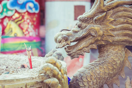 steel bucket: Close up steel dragon statue on incense bucket in Chinese temple