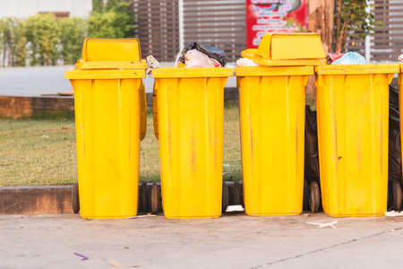big bin: Yellow big plastic bin on the street