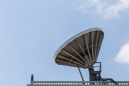 rooftile: Big satellite dish on the roof with blue sky background