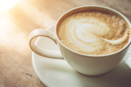 Close up white coffee cup on the table at morning time Stock Photo