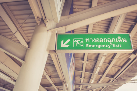 Emergency exit sign in skytrain station, Bangkok, Thailand photo