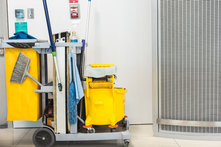 mopped: Yellow mop bucket and set of cleaning equipment in the airport