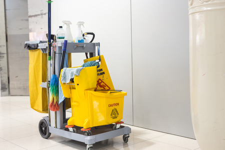 cleaning equipment: Yellow mop bucket and set of cleaning equipment in the airport