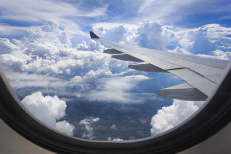 View of beautiful cloud and wing of airplane from window Reklamní fotografie - 40397021