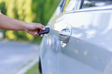 lock: Close up woman hand holding key of new car