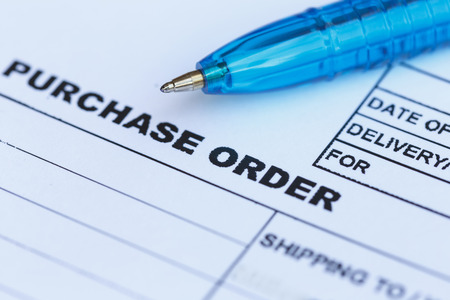 Close up purchase order with blue pen in the office‏