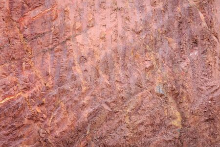 red soil: Texture of mountain showing red soil and rock after excavated