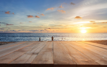 beautiful sunset: Close up top of old wooden table at sunset beach in Thailand Stock Photo