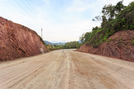Texture of mountain showing red soil after excavated to build the road Stock Photo