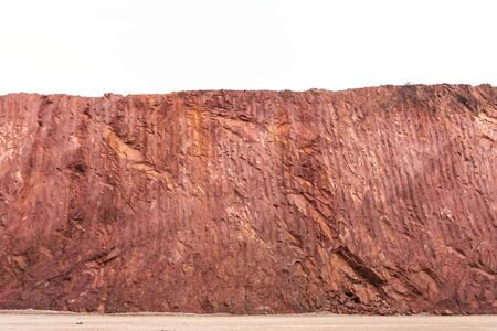 red soil: Texture of mountain showing red soil after excavated to build the road Stock Photo