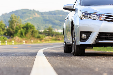 Close up front of new silver car parking on the asphalt road Stockfoto