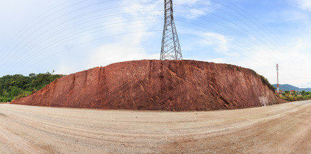 red soil: Texture of mountain showing red soil after excavated to build the road, Panprama Stock Photo