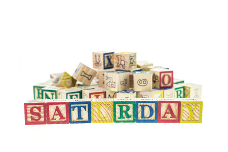 studio b: Saturday written in letter colorful alphabet blocks isolated on white background